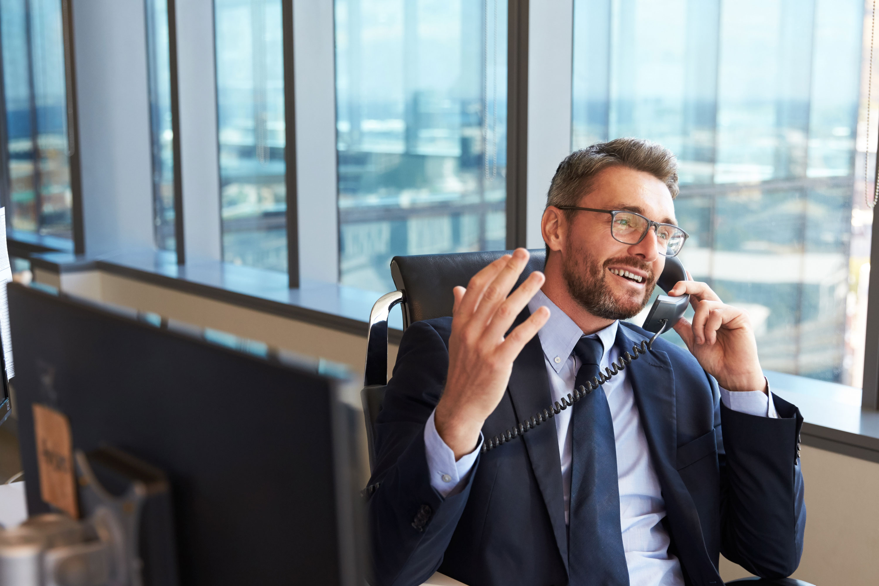 Photo of business man using phone in corporate office