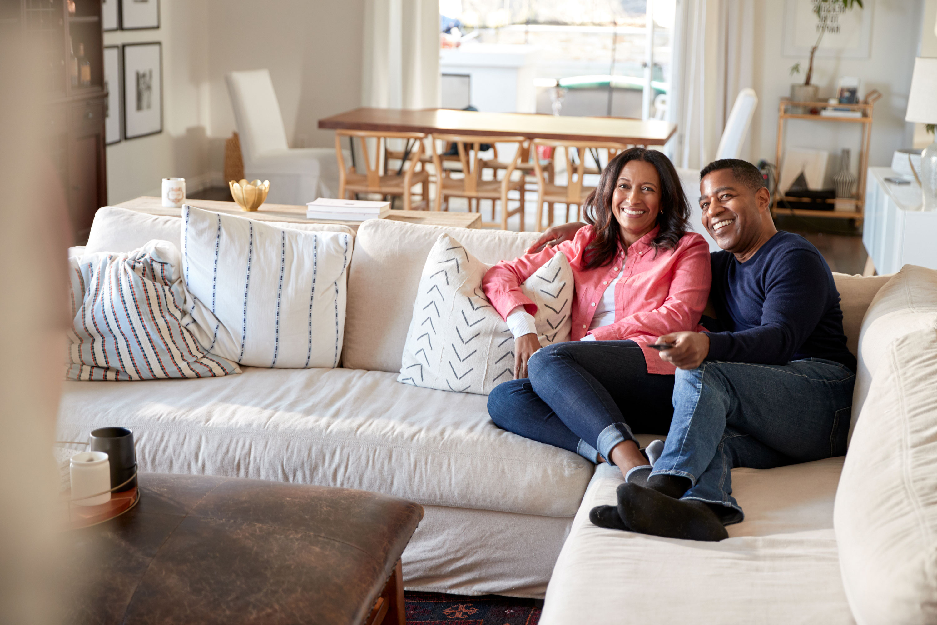 Photo of couple watching tv on couch