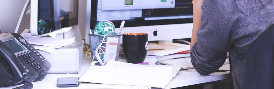 Photo of a busy woman work at her desk