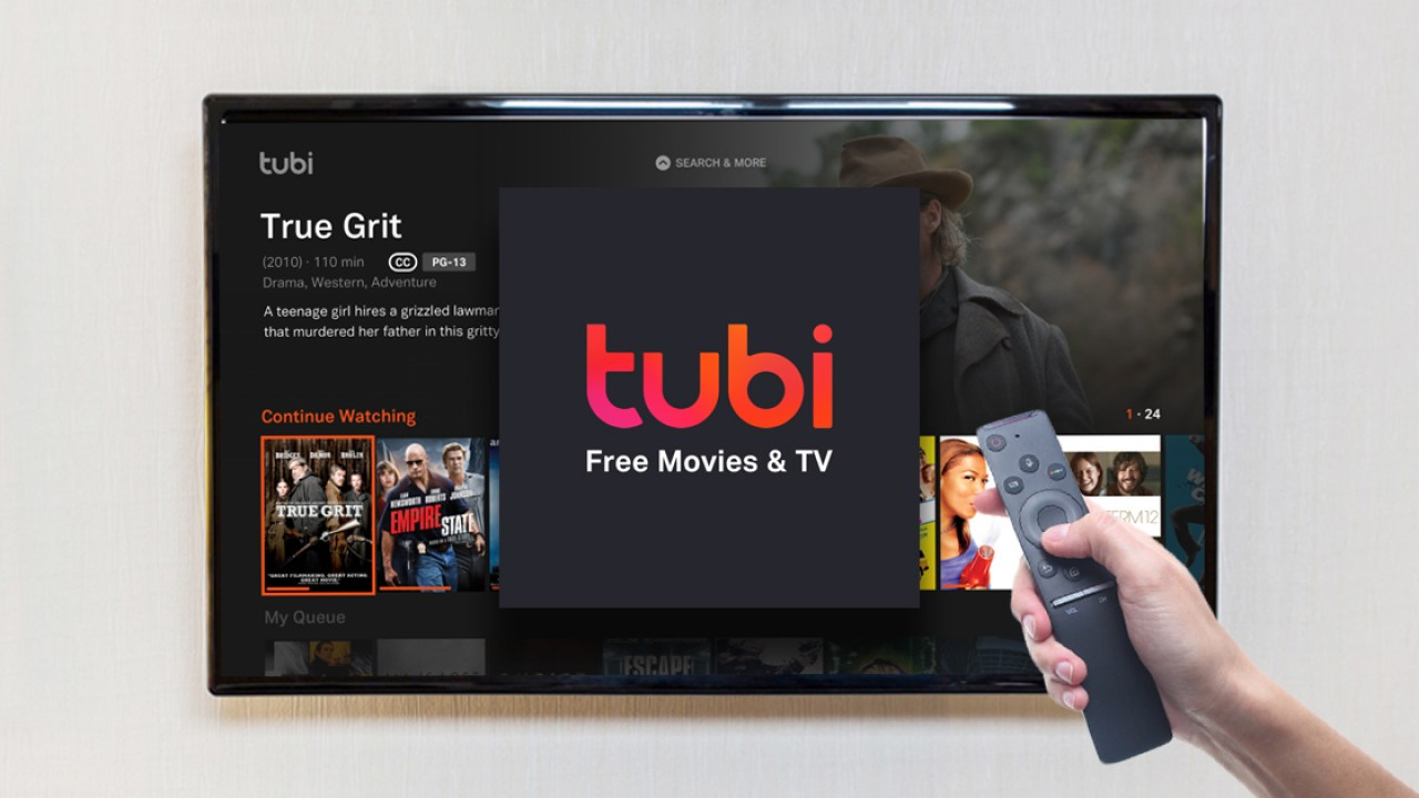 Streaming-Blog-Tubi-App-Icon-On-Tv-Screen-With-Hand-Holding-Remote-in-Front-of-it.jpg