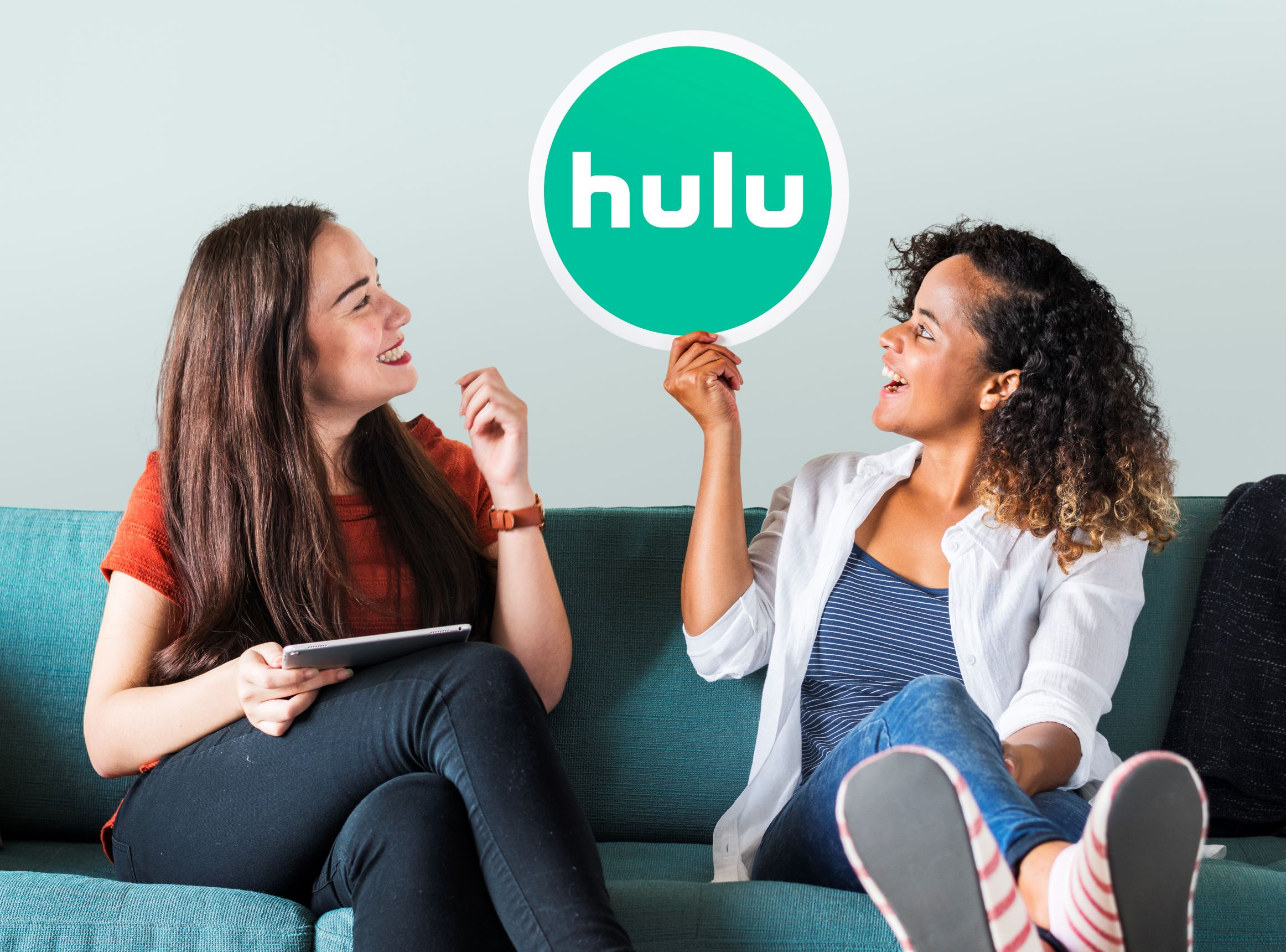 Streaming-Blog-Two-Girls-on-Couch-Holding-Hulu-Sign.jpg