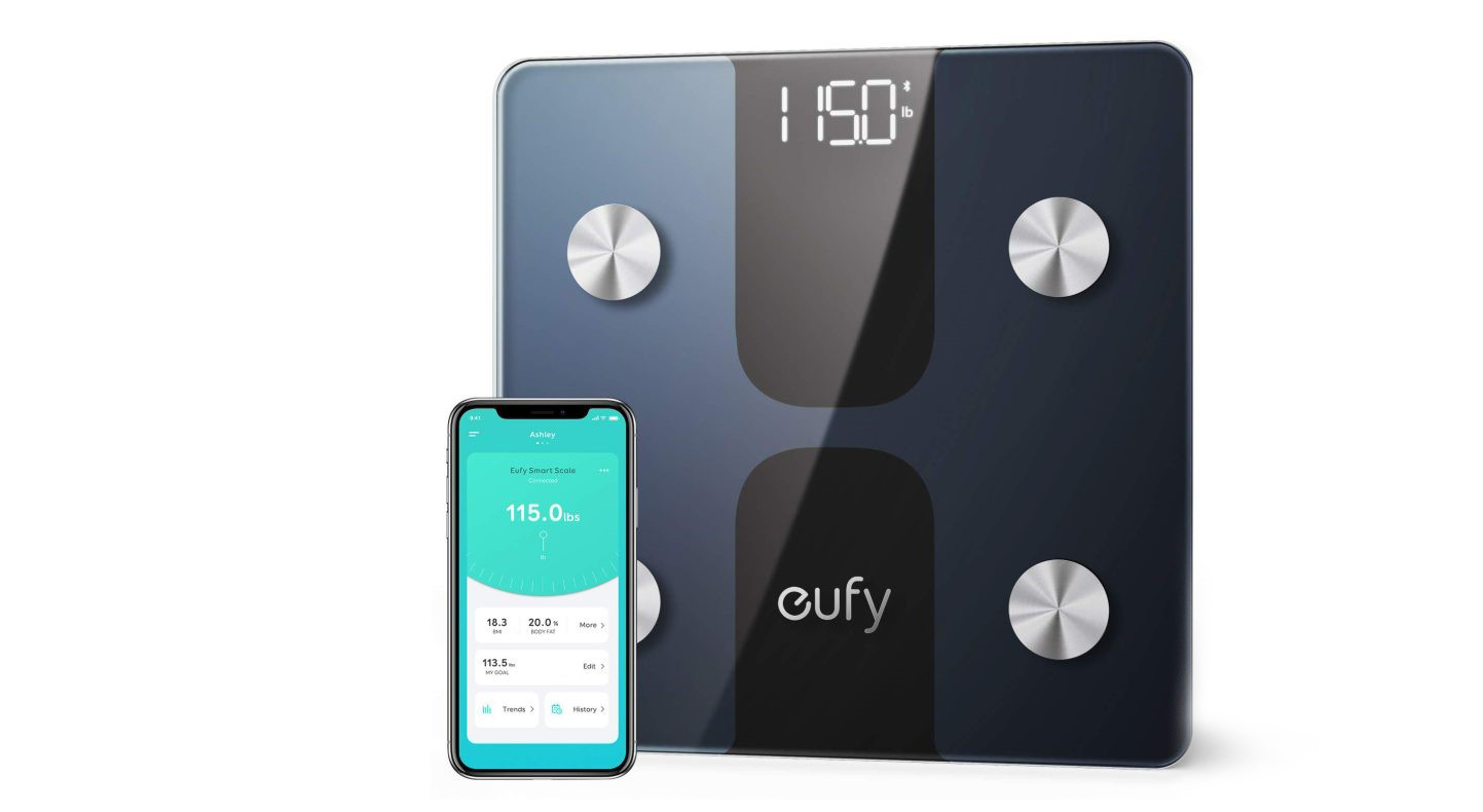 Tech-Gift-Guide-Eufy-Smart-scale-next-to-mobile-phone-on-white-background.jpg