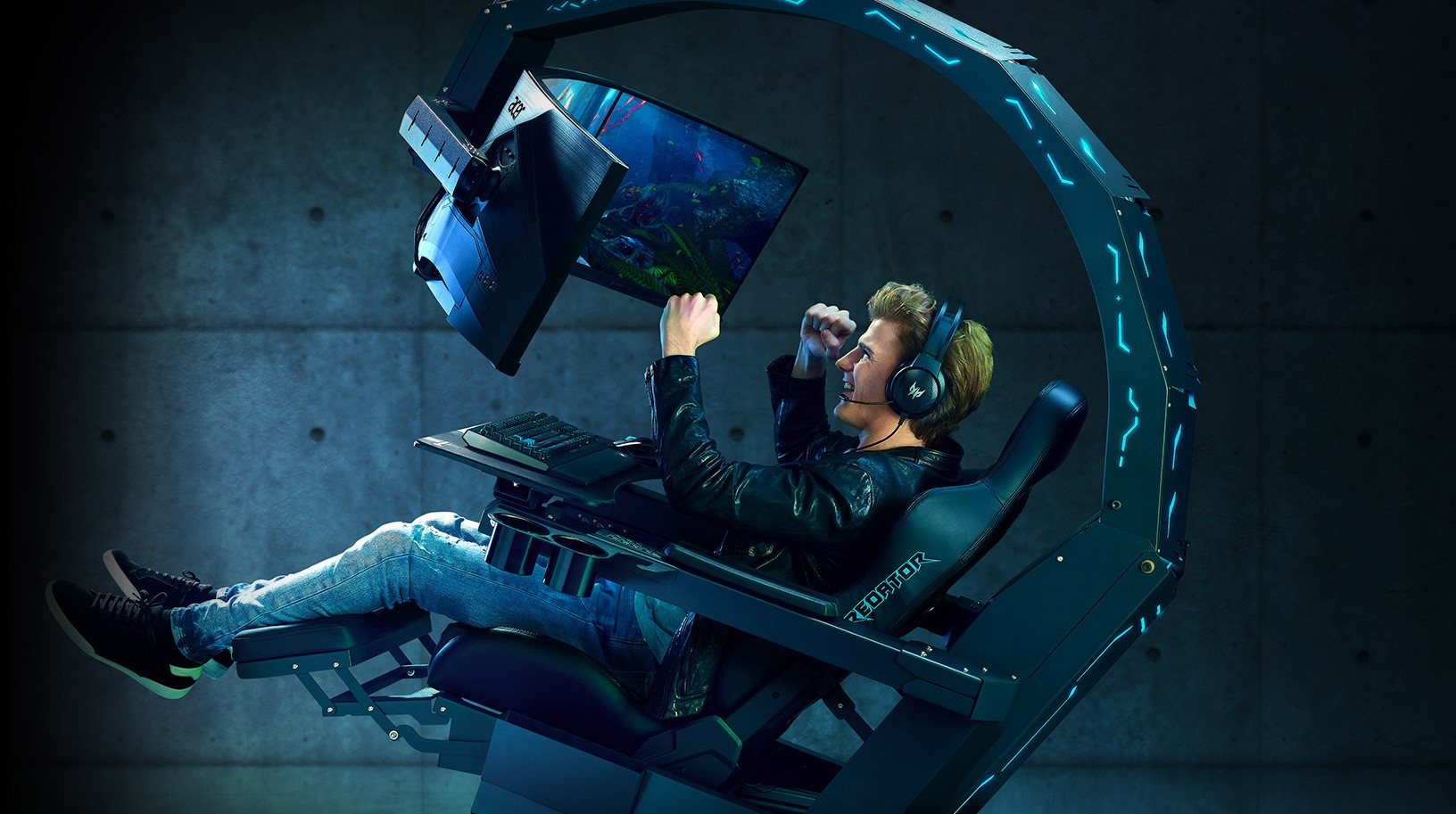 Tech-Gift-Guide-Man-in-Acer-Predator-Throne-cheering-as-he-plays-game.jpg