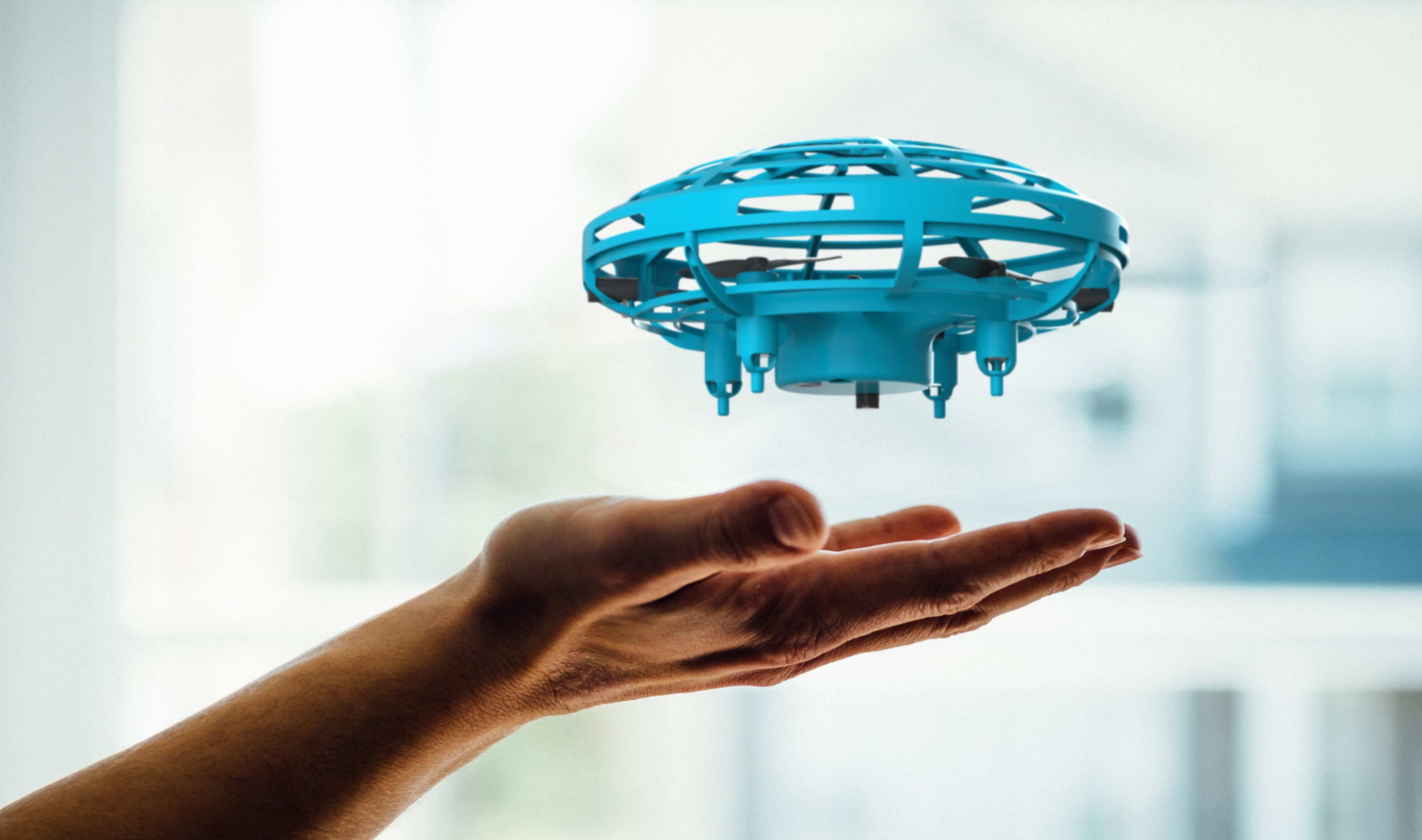 Tech-Gift-Guide-MyFirst-drone-hovering-above-hand.jpg