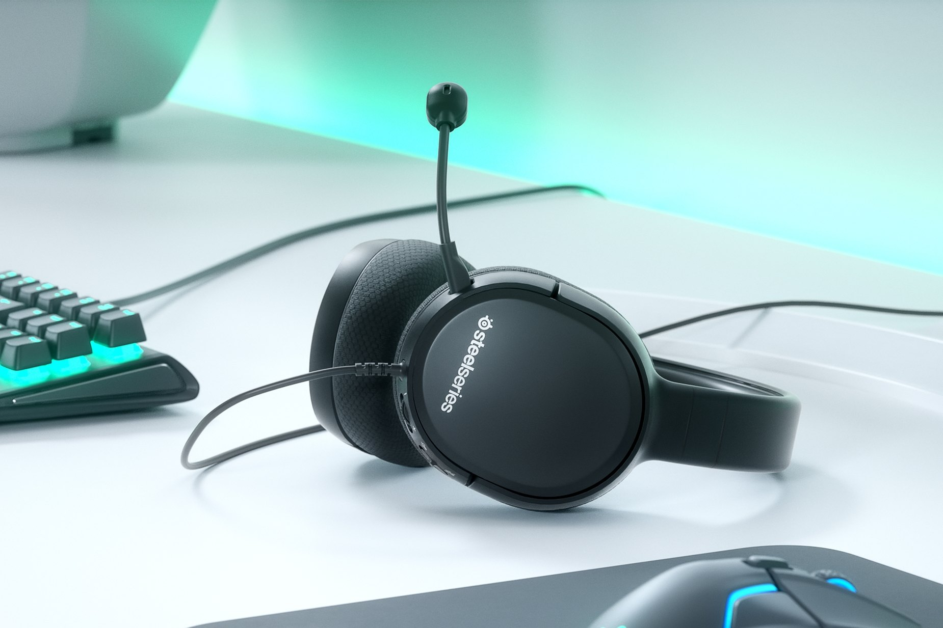 Tech-Gift-Guide-SteelSeries-Arctic-headset-sitting-on-table-near-computer.jpg