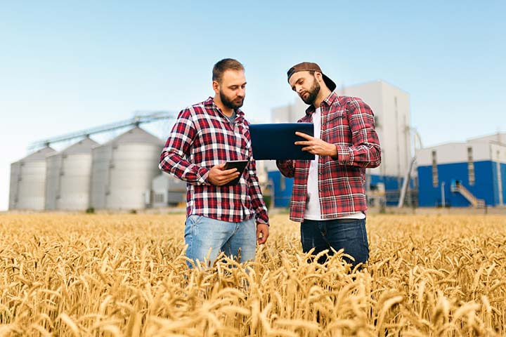 Photo of farmers using tablets to manage crops