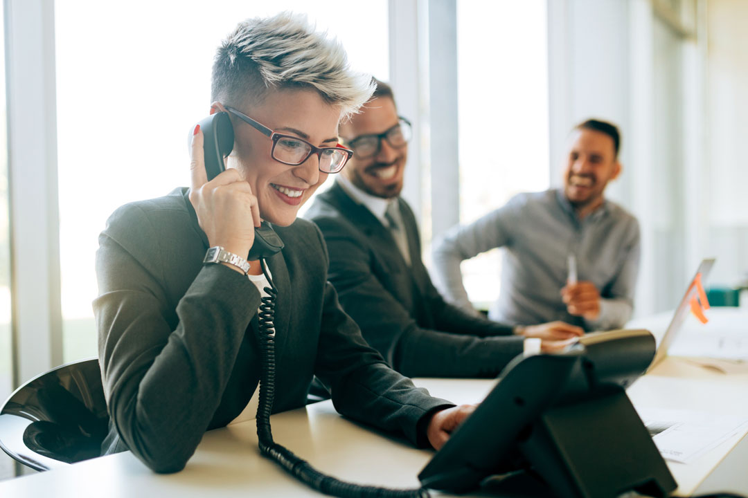 Photo of business woman making phone call during meeting