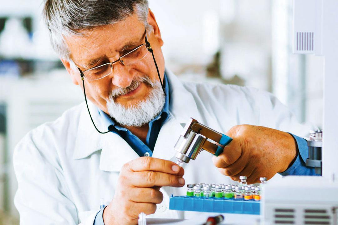 Photo of male laboratory technician running tests