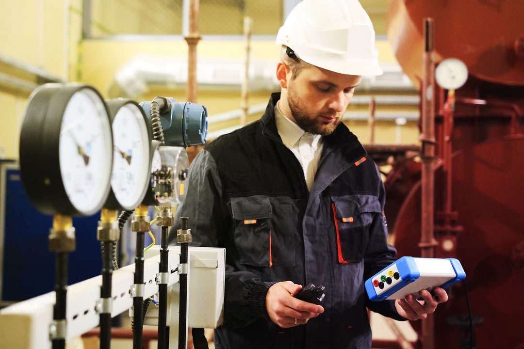 Photo of engineer checking temperature levels in plant
