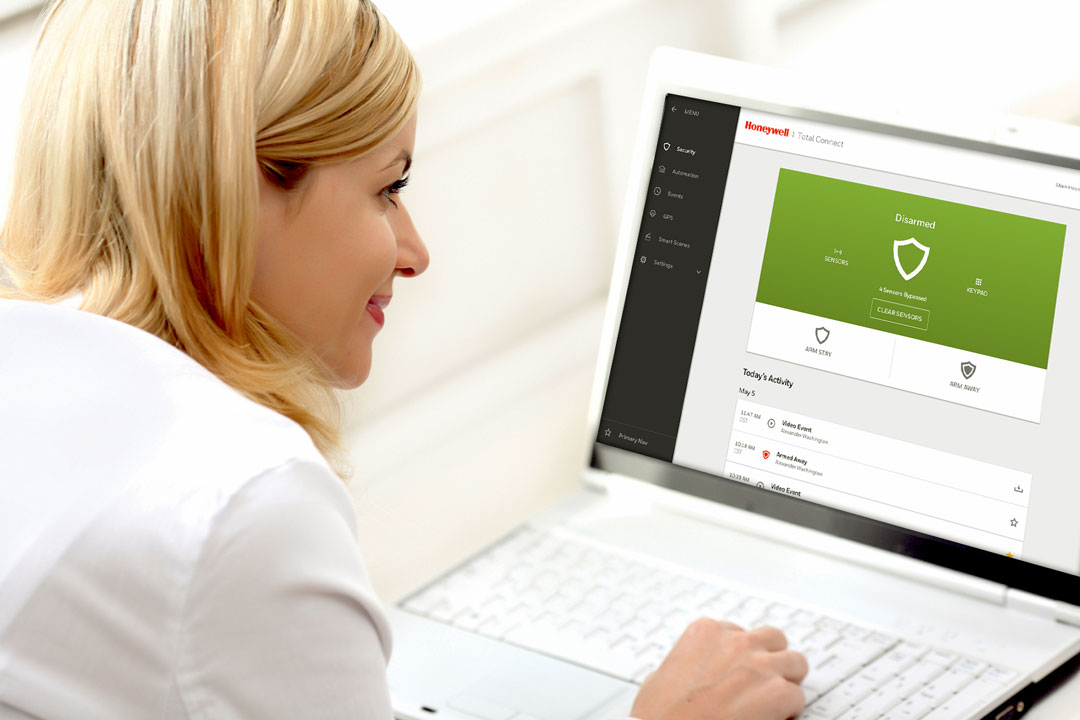 Photo of business woman setting security system with laptop
