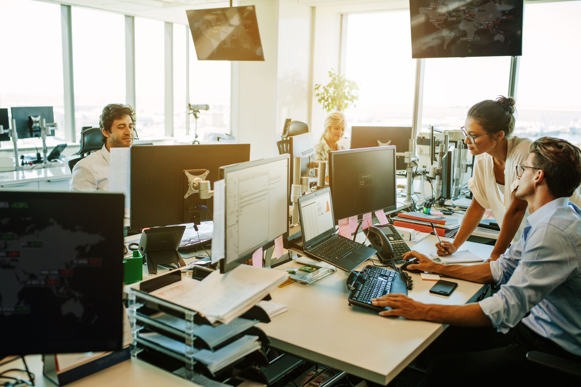 Photo of business team work at their desks