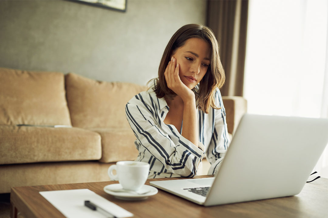 Photo of business woman working remotely from hotel room