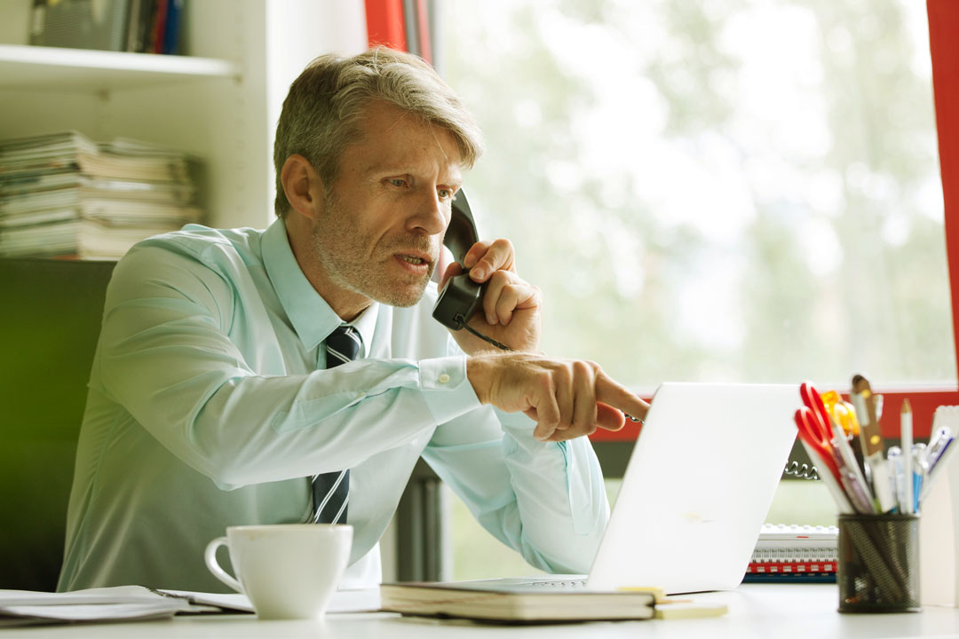 Photo of businessman actively monitoring his business