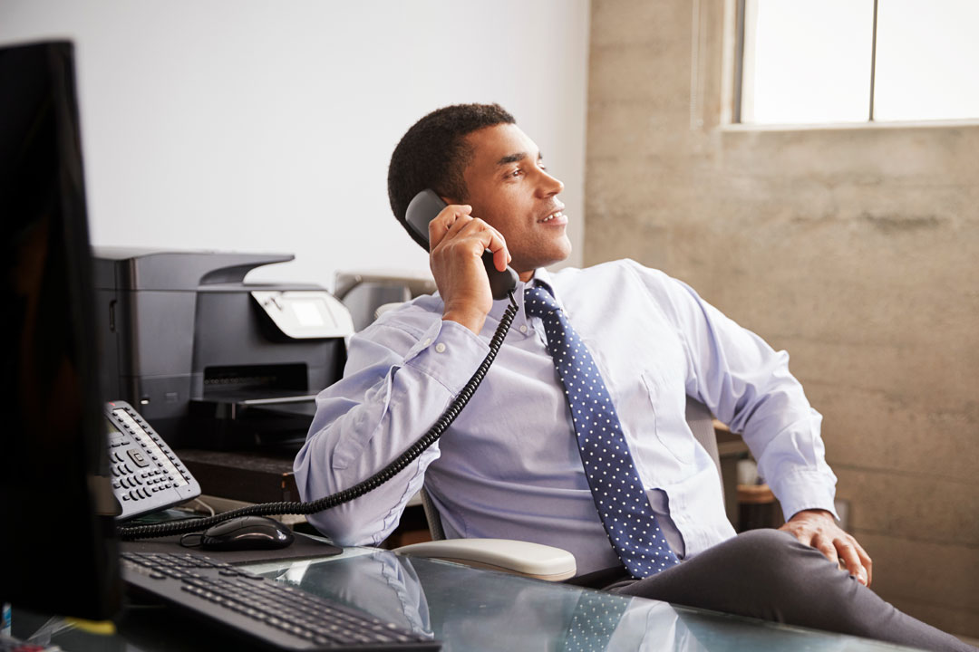 Photo of businessman having relaxed conversation on phone