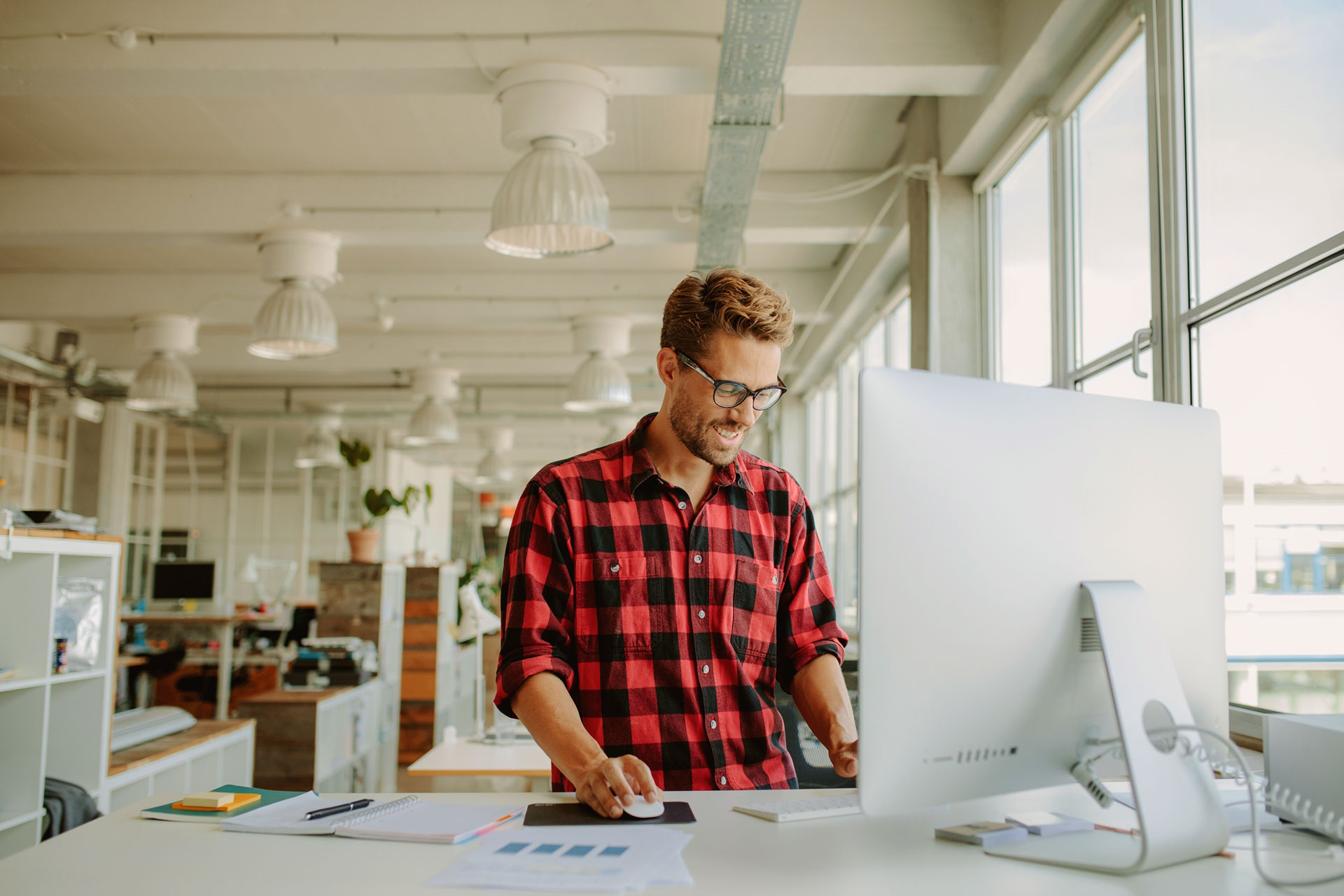 Photo of young businessman working at desk