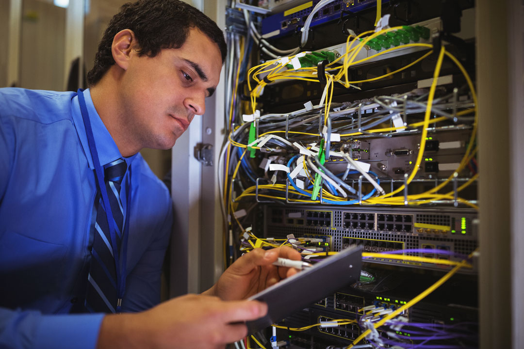 Photo of network administrator monitoring servers