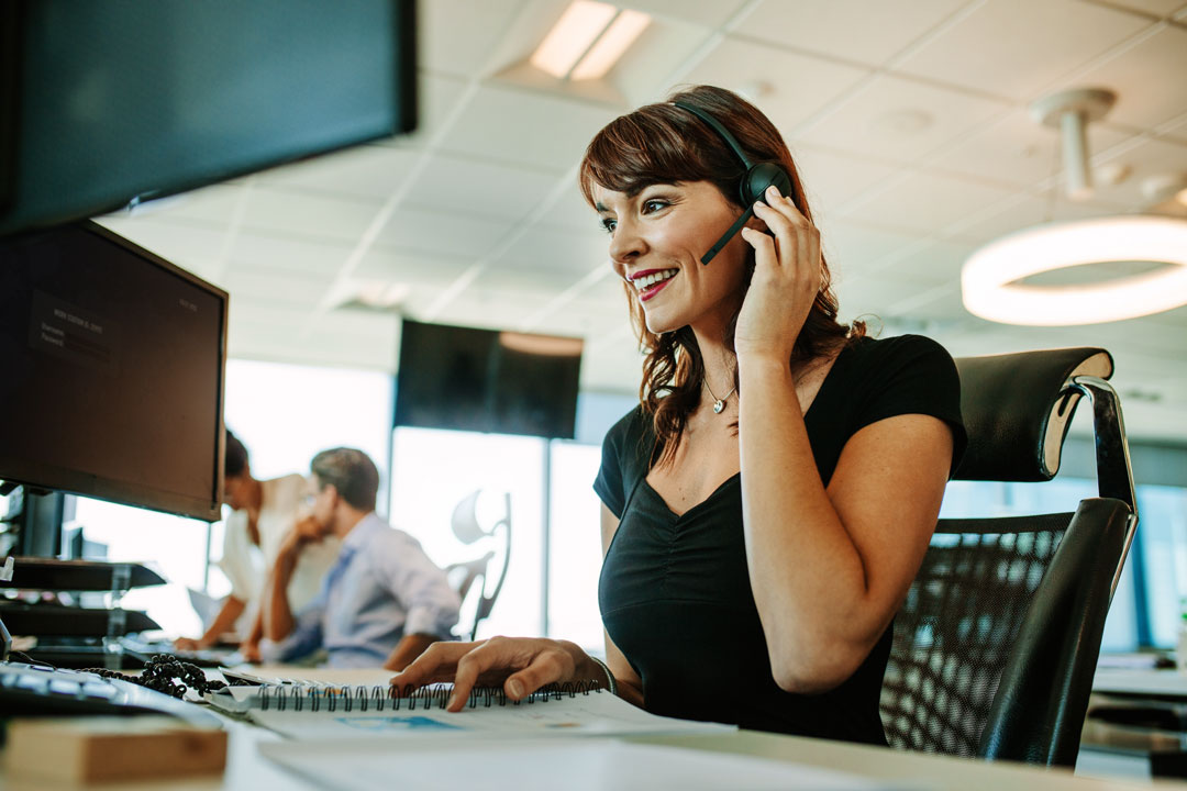 Photo of female customer support talking on phone
