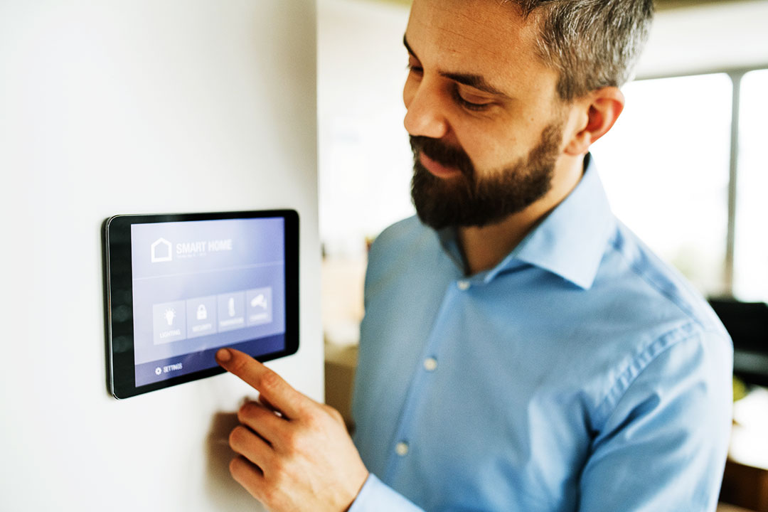 Photo of a man using a smart control panel