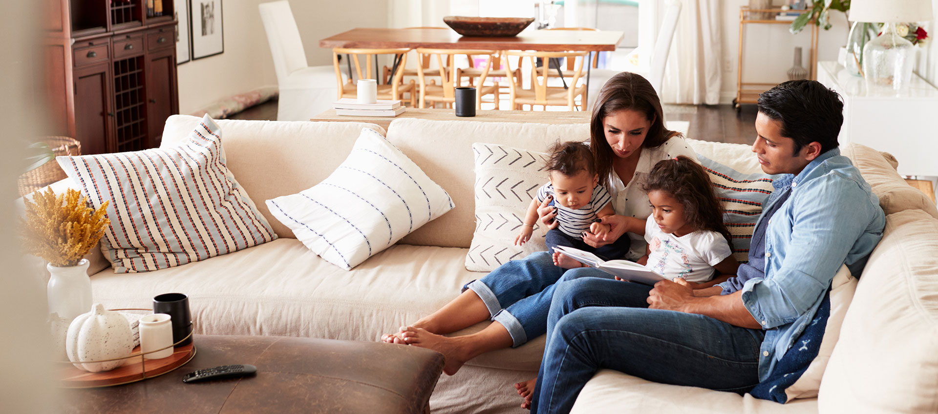 Photo of hispanic family spending time together on the couch
