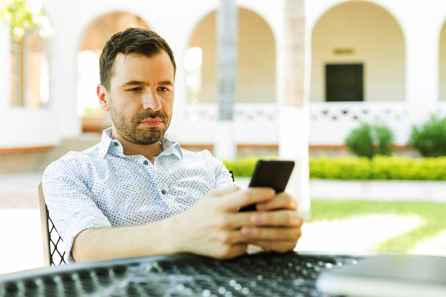 Photo of man checking email on his phone